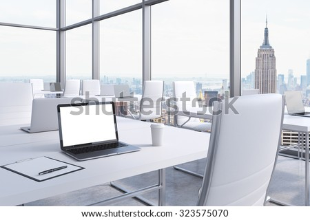 Workplaces in a modern corner panoramic office in Manhattan, New York City. White tables and white chairs. A laptop with a white screen, notepad and a coffee cup. 3D rendering. - stock photo