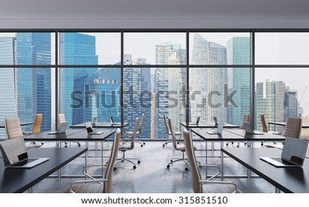 Workplaces in a modern panoramic office singapore city view from the windows open space