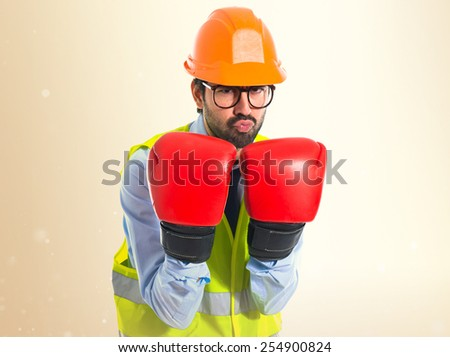 Workrt with boxing gloves  - stock photo