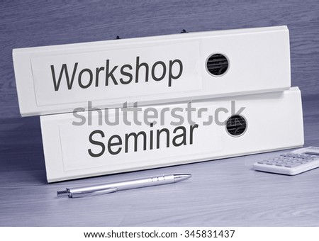 Workshop and Seminar - two binders with text in the office