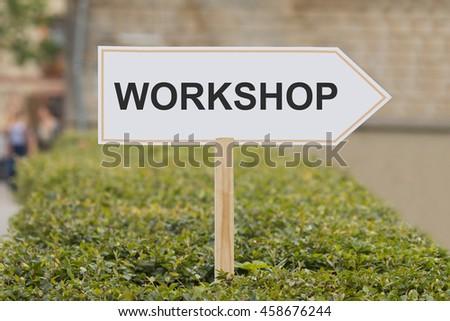 workshop signpost - stock photo