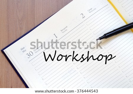 Workshop text concept write on notebook
