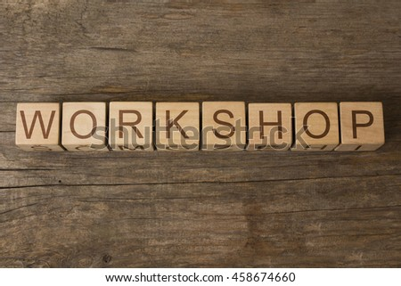 workshop text on wooden cubes - stock photo