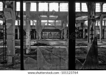 workshop through the broken windows - stock photo