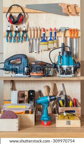 Workshop tool board with various hand tools for repairing and woodworking. - stock photo