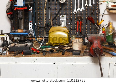 Workshop with different equipment and tools - stock photo