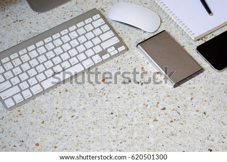 Workspace and office stuff onto granite desk table with copy space..