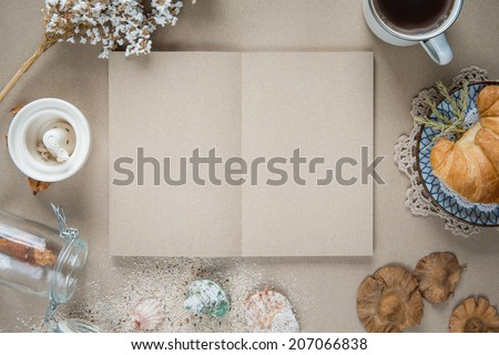 Workspace - Notebook paper with coffee and cookie on table. Back - stock photo