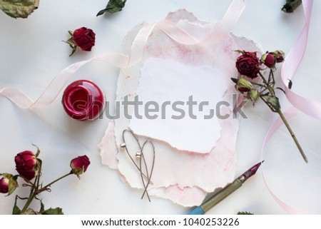 Workspace wedding invitation cards craft envelopes stock photo wedding invitation cards craft envelopes pink roses and green leaves on white stopboris Choice Image