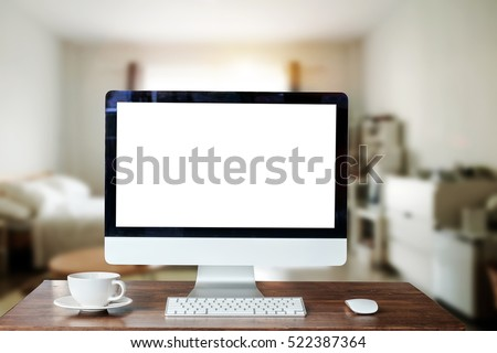 workspace with blank screen coffee cup on a table in bright office room interior bright office room interior