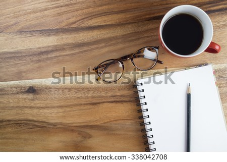 Workspace with coffee cup,note paper and  on wooden table. Business concept. - stock photo