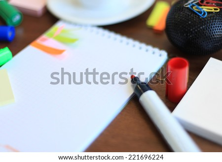 Workspace with coffee cup, note paper on table  - stock photo