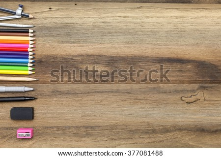 Workstation concept top view : pen,marker,pencil,rubber,sharpener,divider and color pencil on wooden background - stock photo