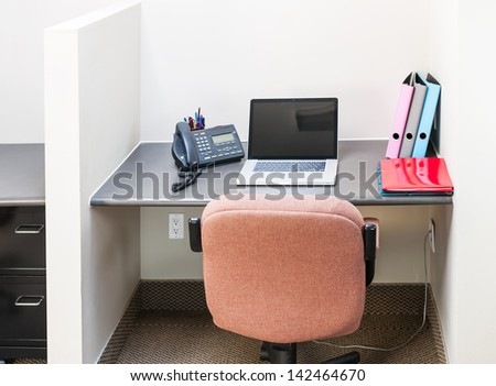 Workstation in office with swivel chair desk and laptop computer - stock photo
