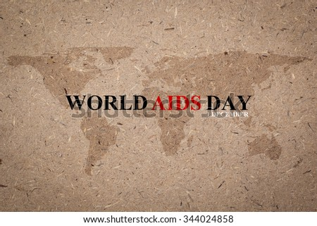 World Aids Day on rough brown paper board backdrop with map atlas:World Aids Day 1 December concept:Human immunodeficiency virus infection:acquired immune deficiency syndrome: - stock photo
