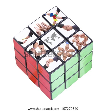 World business inside Six color cube puzzle with clipping path - stock photo