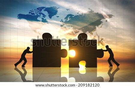 World Business teamwork puzzle pieces. - stock photo