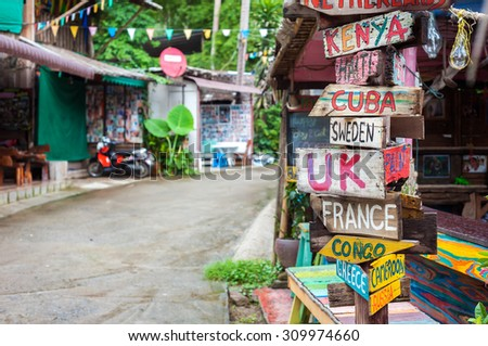 World countries signpost outside a bar at Lonely Beach, Koh Chang, Thailand - stock photo