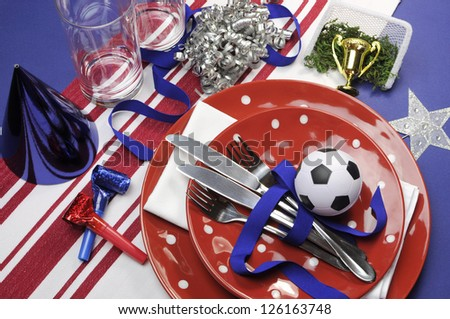 World Cup Soccer football celebration party table settings in red, white and blue team colors. - stock photo