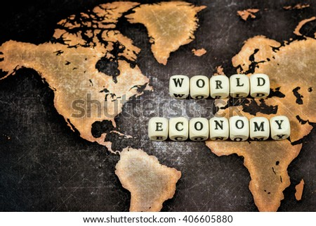 WORLD ECONOMY on grunge world map