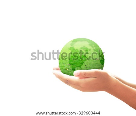 World environment day concept: A green earth globe of grass in human hands isolated on white background.