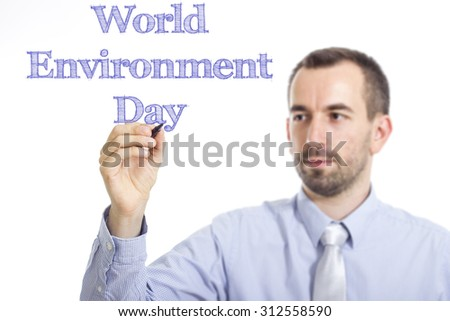 World Environment Day - Young businessman writing blue text on transparent surface