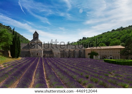 world famous Abbey Senanque and blooming Lavender field under blue sky, France - stock photo