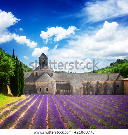 world famous Abbey Senanque and blooming  Lavender field under blue sky, France,  retro toned - stock photo