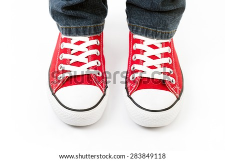 World fashion red retro sneakers on a white background, comfortable and practical footwear for work and leisure - stock photo