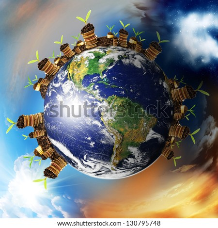 World finance growth. Coins on a surface Earth. Elements of this image furnished by NASA.