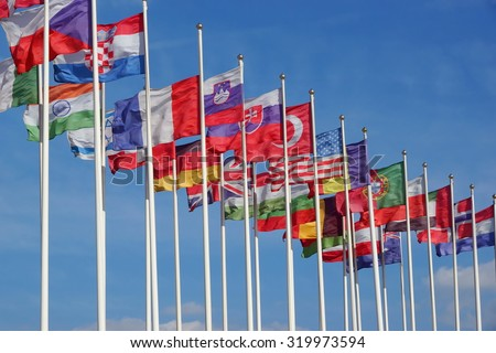 World Flags Blowing In The Wind On The Cloudy Sky Background