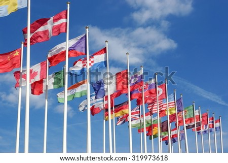 World Flags Blowing In The Wind On The Cloudy Sky Background - stock photo