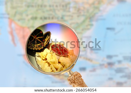 World food, looking in on Mexican nachos with blurred map of North America in the background - stock photo