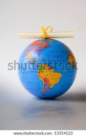 World globe and diploma - stock photo