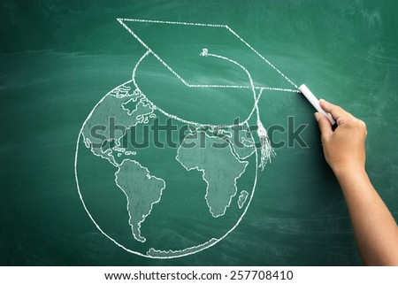 world globe with graduation cap, concept diplomas confessed throughout the world - stock photo