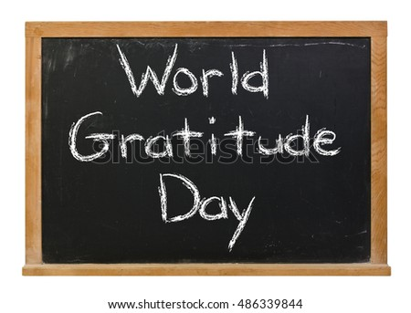 World Gratitude Day written in white chalk on a black chalkboard isolated on white
