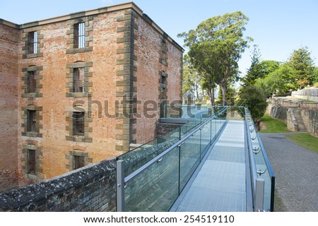 World Heritage Site of  Port Arthur Convict Museum Settlement in Tasmania, Australia, with ruin of historic prison building with modern gangway. - stock photo