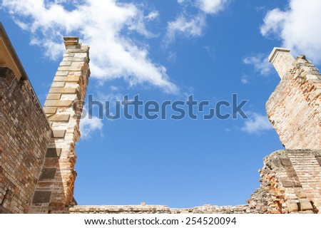 World Heritage Site of  Port Arthur Convict Museum Settlement in Tasmania, Australia, with ruins of historic prison building, tourist attraction, blue sky and copy space. - stock photo