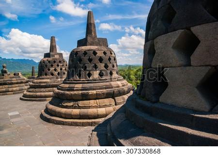 World heritage & the biggest bhuddist temple Borobudur in Yogjakarta in Java, Indonesia - stock photo