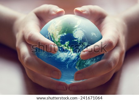 World in human hands - stock photo
