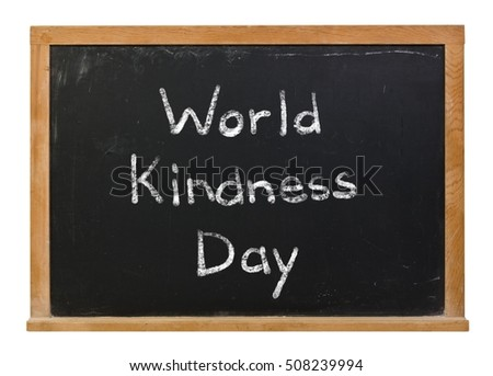 World Kindness Day written in white chalk on a black chalkboard isolated on white