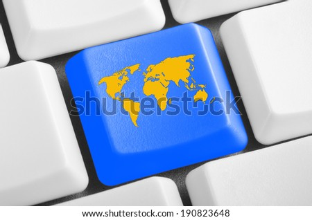world map blue button on the keyboard - stock photo