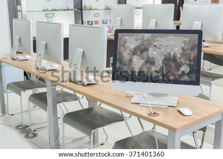 world map communication on desktop background in computer room  - stock photo