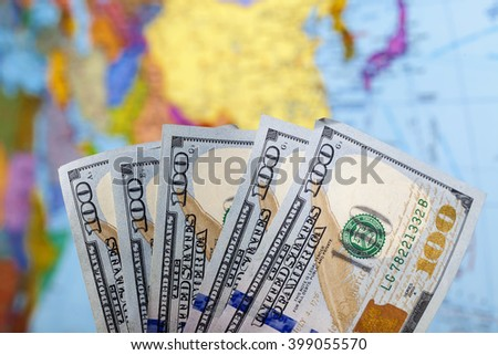 world map on a background of money - stock photo