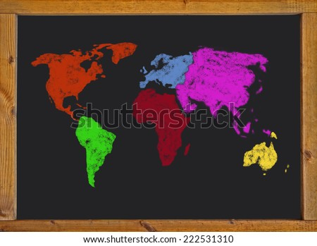 world map on a blackboard - stock photo