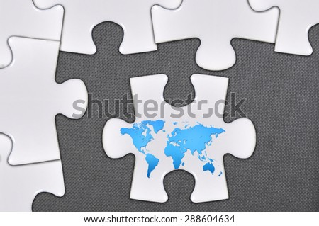 world map on close up puzzle.
