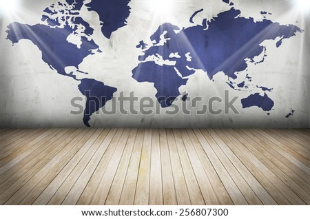 world map on grunge wall and wooden floor - stock photo