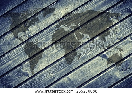 World map on the background of blue wood boards. - stock photo