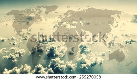 World map on the background of sky with clouds. Vintage style. - stock photo