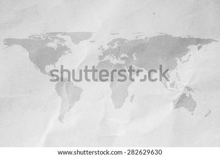 World map on white crumpled paper backgrounds. - stock photo